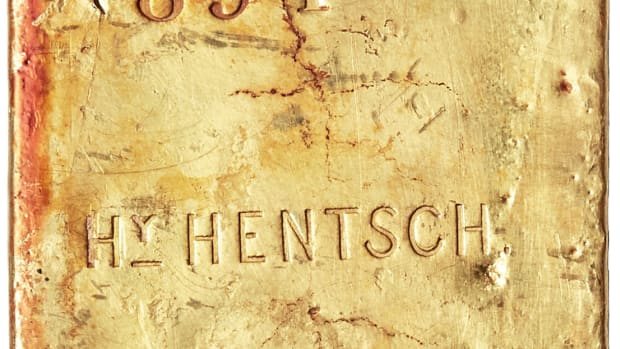 A very large size gold ingot, weighing in at 176.25 from assayer Henry Hentsch, sold for $324,000.