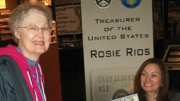 "Nancy Wilson with U.S. Treasurer Rosa ""Rosie"" Gumataotao Rios. Rios is holding the $100 sheet she signed as No. 1 for Wilson."