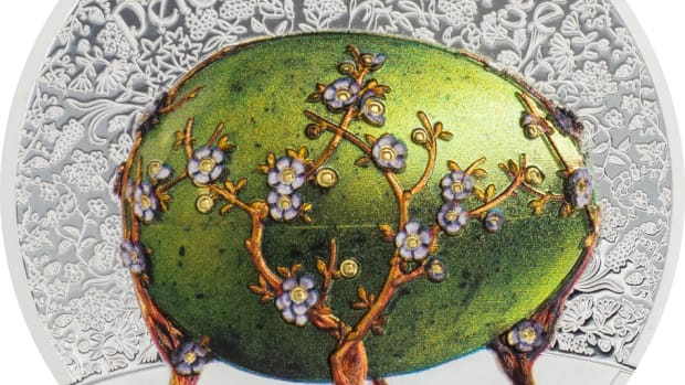 Artfully designed to replicate the original Apple Blossom Egg in all its glory, this high relief beauty comes in an egg shaped metal case with foam padding to keep your memento of the Great Russian jeweler, Peter Carl Fabergé, safe for a lifetime in your collection.