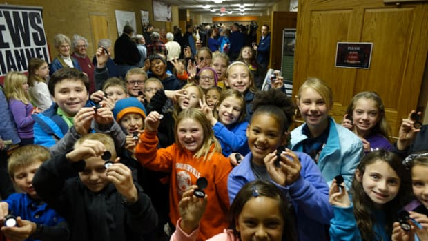 Who says kids can't have fun with coins? Fourth grade students show off their new Saratoga National Historical Park quarters after the launch ceremony in Schuylerville, NY, on Nov. 17, 2015. The coin is the 30th release in the United States Mint America the Beautiful Quarters® Program. U.S. Mint photo by Sharon McPike.