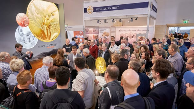 A large crowd gathered to hear the CIT Coin Invest AG announcement of Smartminting Reloaded. Most importantly, they came to see the first coins struck with this new higher relief technology. (Photo by Andreas Schoelzel, courtesy of World Money Fair.)