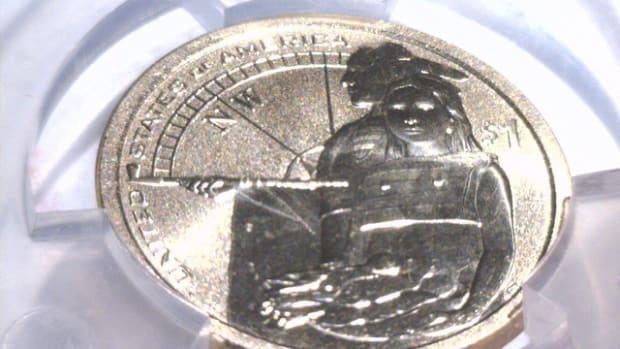 The 2014-D enhanced uncirculated Native American dollar showing its missing edge lettering.