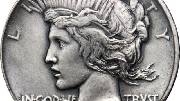 Lot 13166. 1921 Peace silver dollar. High Relief. Sandblast or Matte Finish, Antiqued. PCGS Specimen-64. Ex: Raymond T. Baker Estate.
