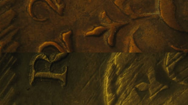 You can see the same depressions on two different fake Wood's Hibernia halfpennies indicating they were struck with the same die.