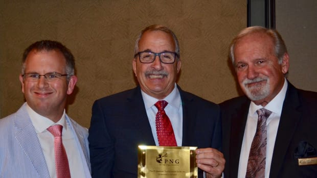 PNG Board member John Brush (left) and Executive Director Robert Brueggeman (right) presented the prestigious PNG Founder's Award to Paul Nugget (center) in 2019.