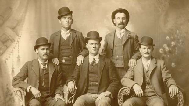 "The iconic image of Butch Cassidy and the Wild Bunch taken at a studio in Fort Worth, Texas in 1900. Shown seated left to right: Harry A. Longabaugh, the ""Sundance Kid""; Ben Kilpatrick, the ""Tall Texan""; and Robert Leroy Parker, ""Butch Cassidy."" Standing left to right: Will Carver, ""News Carver""; and Harvey Logan, ""Kid Curry."""