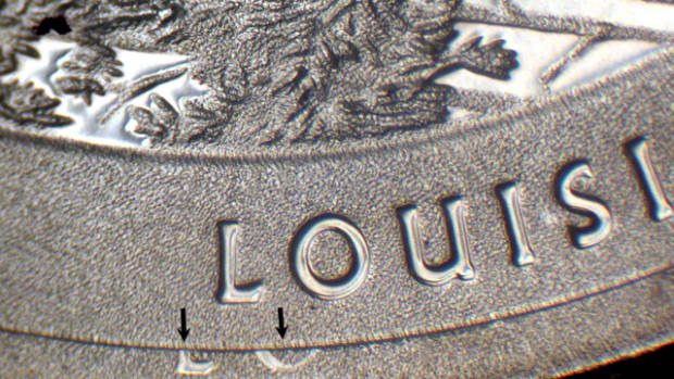 s this Displaced Design-Strike Doubling showing partial letters along the rim of the quarter visually interesting enough to give it collectible value?