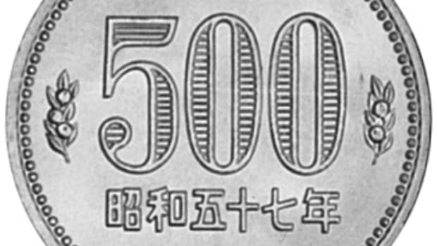 "The current 500 yen is made of Copper-Nickel. Its obverse shows the number ""500"" surrounded by cherry blossoms. (Image courtesy of NGC.)"