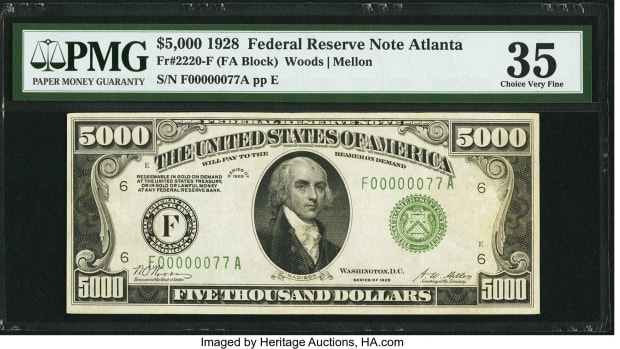 Shown is the Fr. 2221-E $5,000 1934 Federal Reserve Note graded About Uncirculated 55 by PMG.