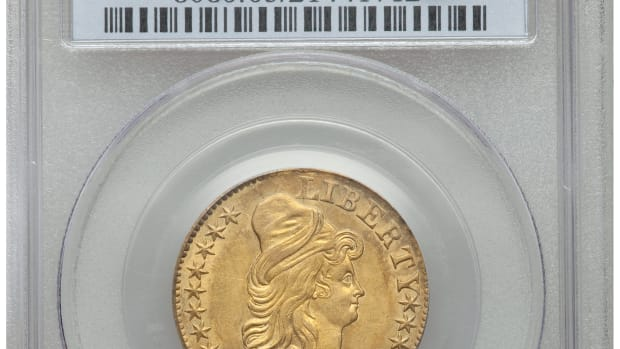 Insert image 1804 Small Over Large 8 in holder with caption:  1804 $5 Small Over Large 8, BD-7, R.4, MS-63 PCGS. CAC. This coin realized $54,000 including the buyer's premium.