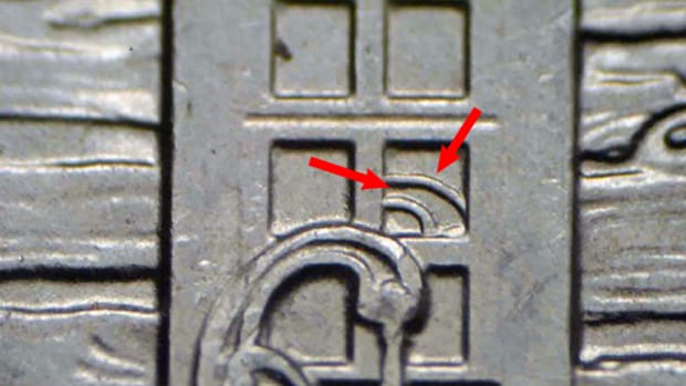 This example of the Homestead quarter distinctly shows the pump handles in the window pane area.
