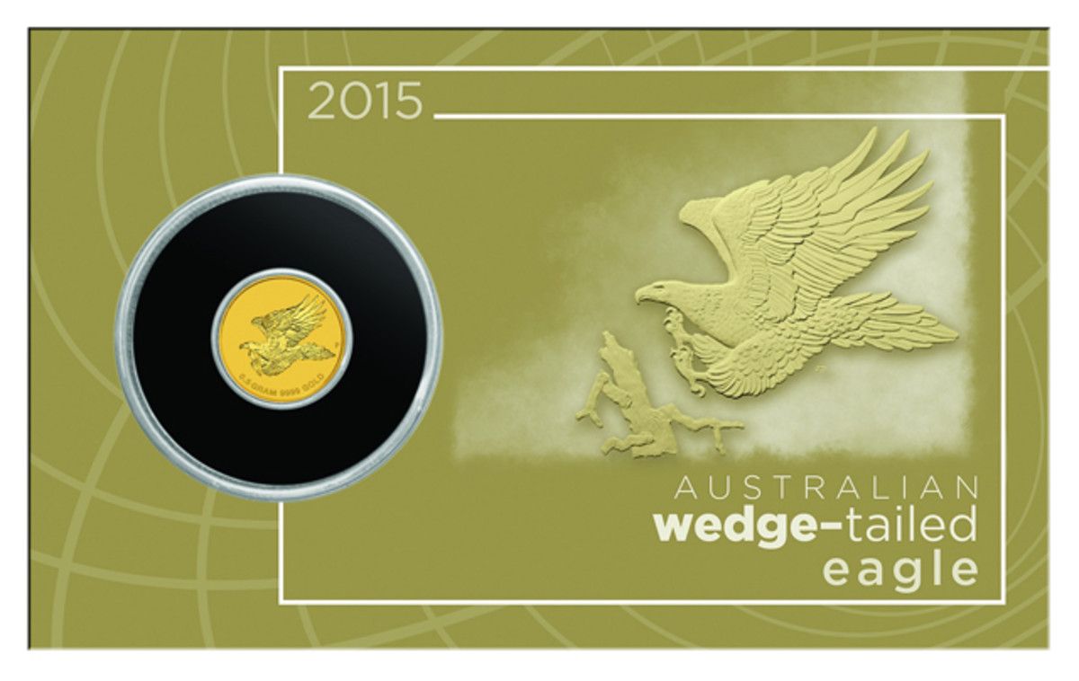 Perth's tiny $2 gold Wedge-tailed Eagle coin on its colored card mount as issued.