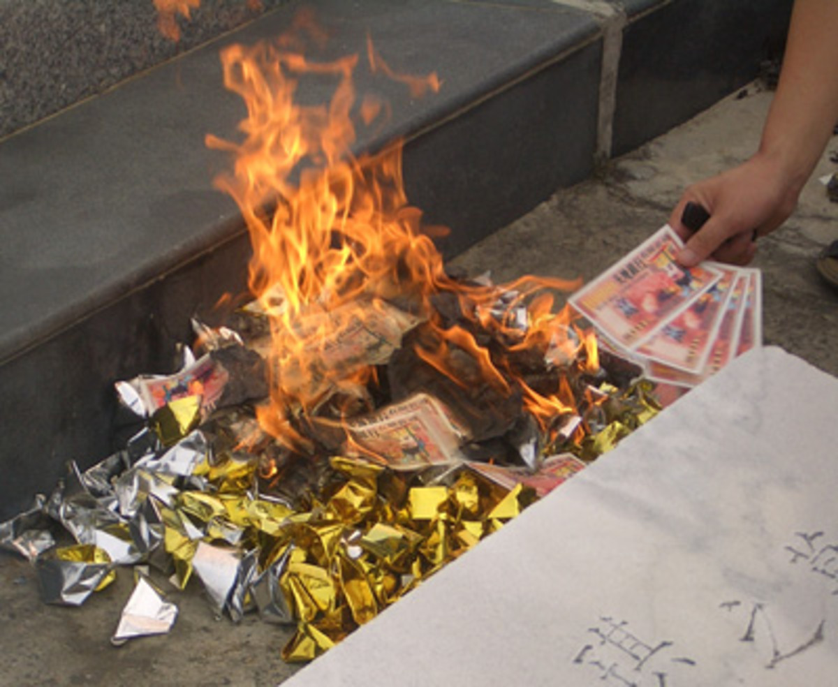 Hell bank notes, which are paper money resembling the real stuff, are burned at the graves of ancestors to ensure the deceased doesn't lack for money during the coming year. (By Vmenkov - Own work, CC BY-SA 3.0, https://commons.wikimedia.org/w/index.php?curid=4862200)