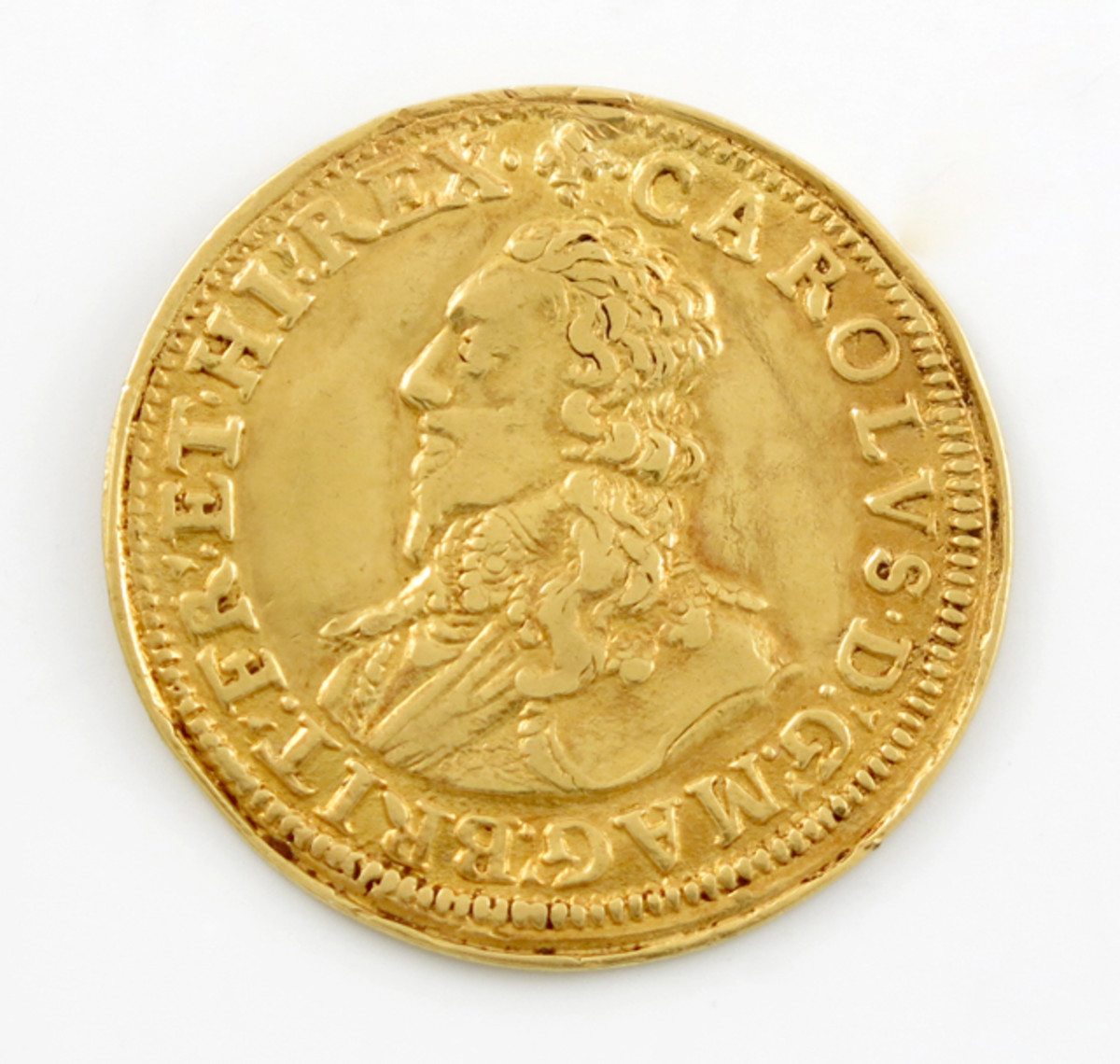 Extremely rare Charles I pattern gold unite, by Abraham Vanderdoort. The legend on the reverse, FLORENT CONCORDIA REGNA [United kingdoms flourish], appears on all of Charles' Tower Mint-struck gold and refers to the unification of England, Ireland and Scotland under the Stuarts. However, the lis mintmark is unusual on a Tower coin. In VF the coin carries an estimate of  £8,000 – £10,000.