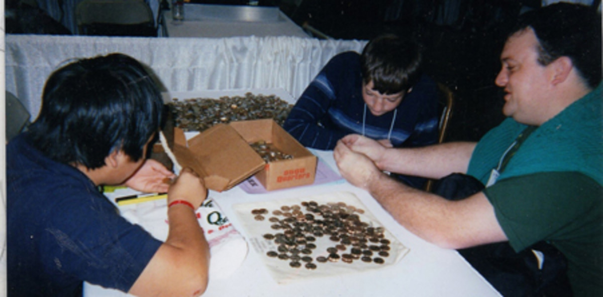 """Father and sons attending the Santa Maria Coin Show May 5 search for """"P"""" and """"S"""" mintmarked America the Beautiful quarters."""