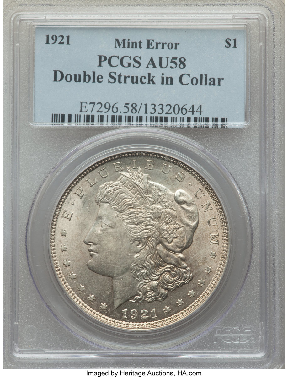 Double struck in collar, this 1921 Morgan dollar, graded AU-58 PCGS sold for $2,666.40.  While the initial strike was normal, the coin was not ejected and was struck again with a slight counter-clockwise rotation between strikes.  Evidence of the second strike is strongest on ONE DOLLAR, AMERICA, and PLURIBUS UNUM. (Image courtesy of Heritage Auctions)