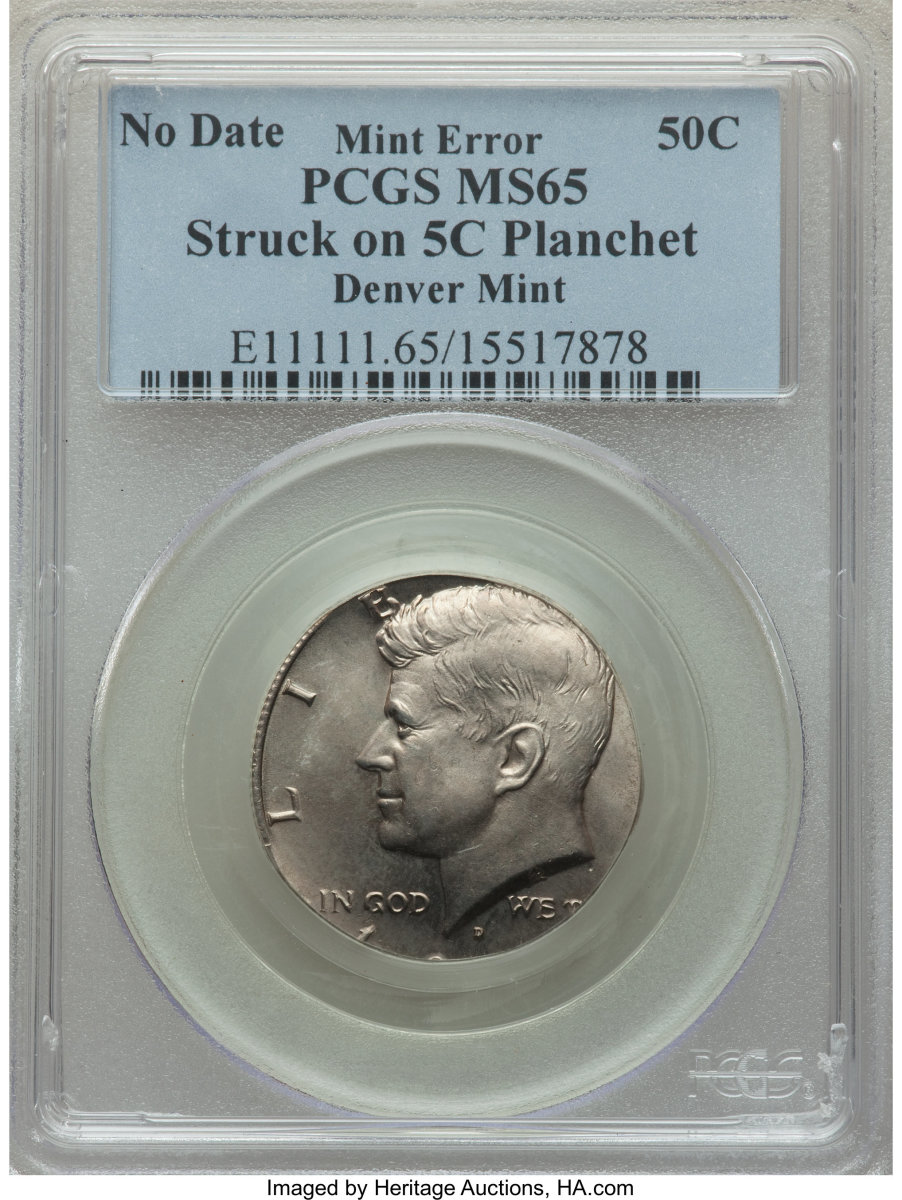 A Kennedy nickel.  Well actually, it's a no date 50C Denver Mint Kennedy half dollar struck on a five cent planchet.  Definitely a challenging planchet combination!  Graded MS-65 PCGS it sold for $1,170.