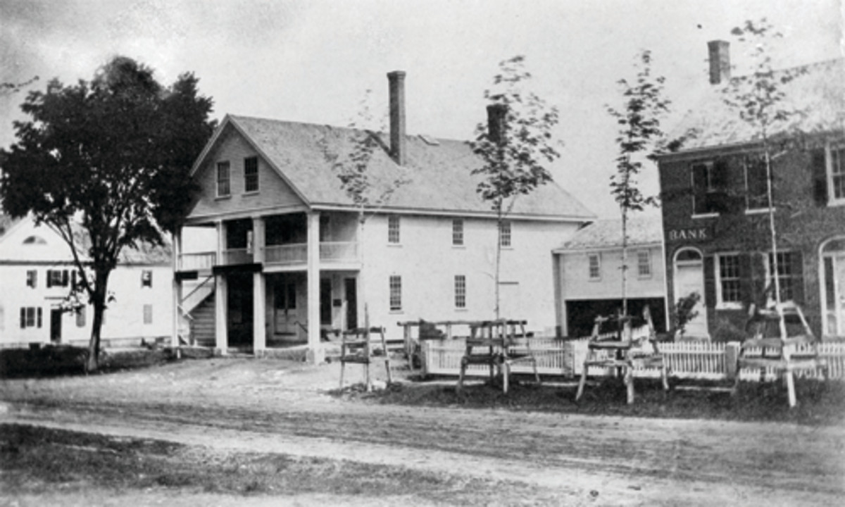 The Wolfborough Bank Building as it appeared in the 1850s (see door and sign on the building to the right). KellerWilliams Real Estate (Adam Dow) is there now.