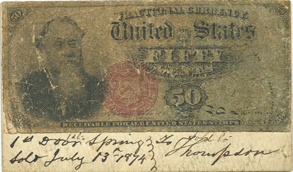 Fig. 2: Worn 50-cent Fractional Currency note, found affixed to the calling card of an apothecary business, with note of a sale at bottom.
