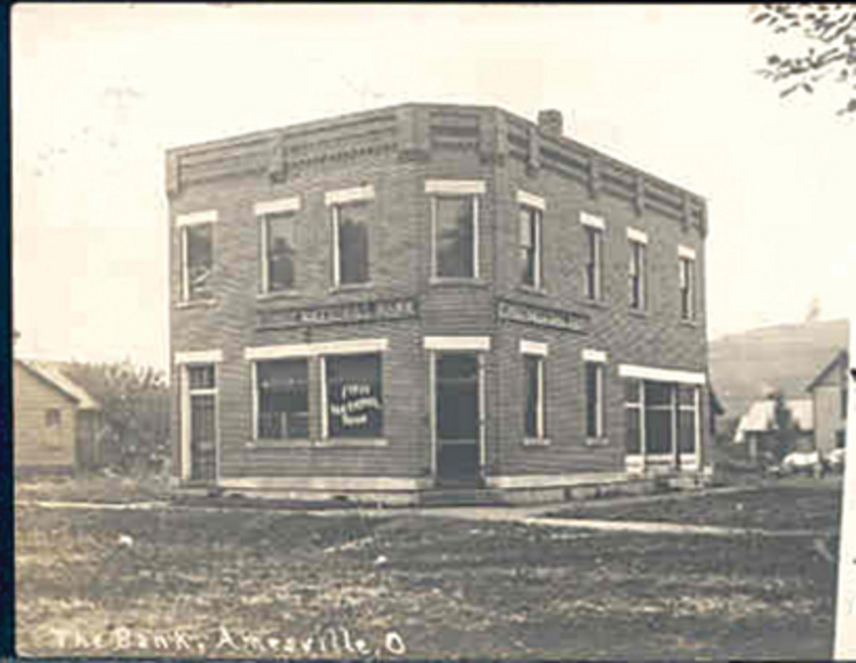 This vintage photo shows the First National Bank of Amesville, Ohio, on its central corner just after completion of the building in 1905. Note the dirt streets.