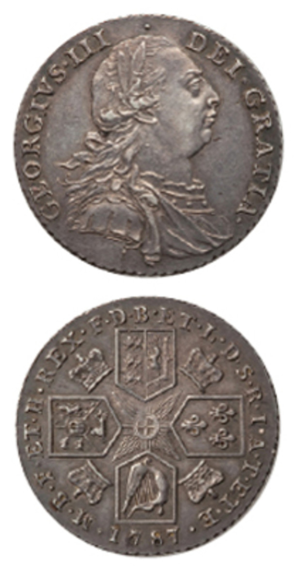 "George III shilling of 1787 with semée of hearts on the Hanoverian shield (KM-607.2, S-3746, ESC-1225.). Note on the obverse that the wreath's upper leaf does not extend into the field, there is no ""S"" curl in front of the king's ear, and the legend has three stops. Once again, the letters of the legend have fish-tailed ends consistent with an 18th century circulation silver coin. (Image courtesy & © www.ha.com)"