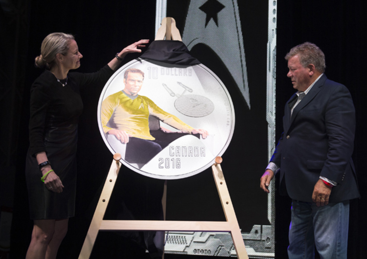 Canadian actor and James Tiberius Kirk's alter-ego, William Shatner, and Royal Canadian Mint President and CEO Sandra Hanington unveil the first coin in the new RCM collection celebrating the 50th anniversary of Star Trek: The Original Series, on May 12, 2016. Image courtesy RCM.