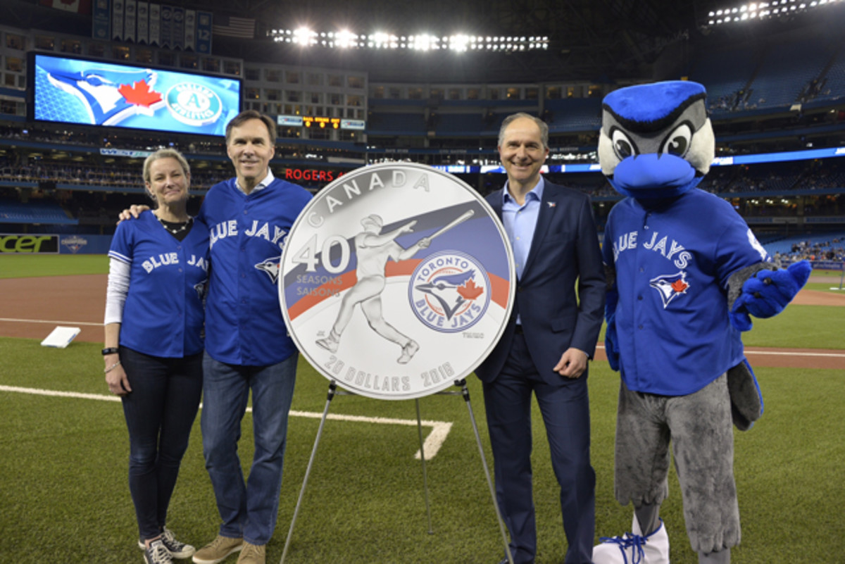From left:  Royal Canadian Mint CEO Sandra Hanington, Minister of Finance Bill Morneau and Robert Witchel, Executive Director of Jays Care Foundation on April 22 unveil a new silver collector coin at Rogers Centre to celebrate the 40th season of the Toronto Blue Jays.