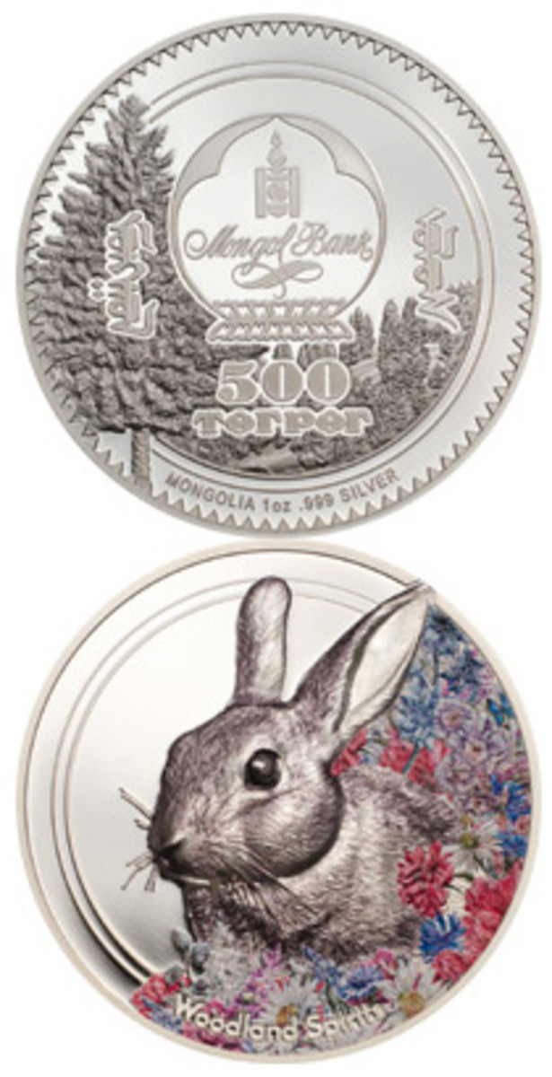 The obverse (top) depicts a forest scene in the background and, in the front, the emblem of the central bank of Mongolia below in Cyrillic lettering and 500 Togrog in Latin lettering MONGOLIA 1 oz .999 SILVER. The reverse (bottom) features the slightly left-facing portrait of a rabbit hiding in a field of flowers. Below is the title of the series, Woodland Spirits, and well hidden in the field on the right is the year of issue 2019.