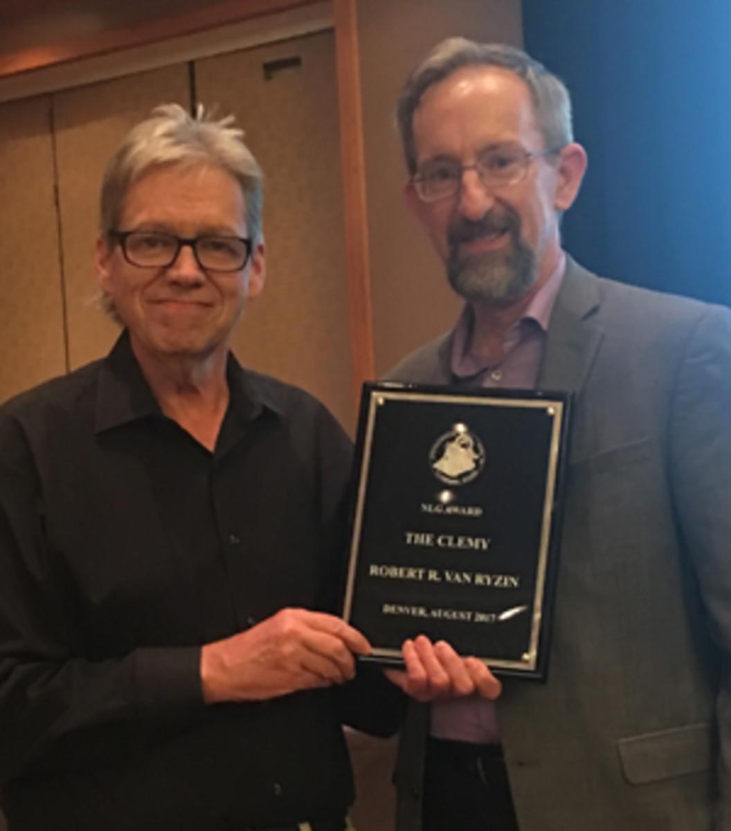 Robert R. Van Ryzin, left, receives the 2017 Clemy Award from 2016 recipient, Mark Borckardt, at the NLG Bash in Denver.