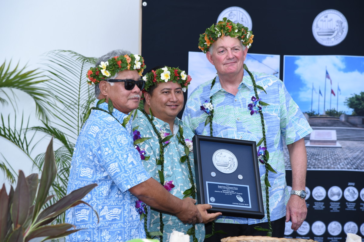 U.S. Mint Director David J. Ryder (right), presents American Memorial Park quarters struck on the first day of production to Northern Mariana Islands Lieutenant Governor Arnold Palacios and Governor Ralph Anthony Deleon Guerrero Torres at the April 30 quarter launch ceremony in Garapan, Saipan. U.S. Mint photo by Sharon McPike.
