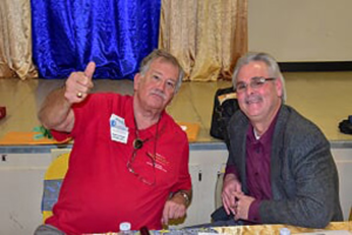 Delta Coin Club President Ed Hohe, right, and the Annual Dinner's emcee Michael S. Turrini relax during a break and share the fellowship of the hobby.
