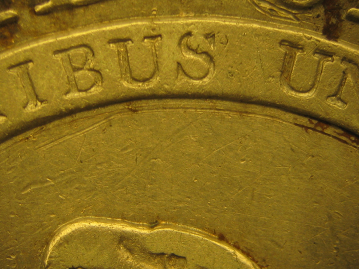 A more significant scratch under the banner on the reverse of the Capped Bust half dollar in Figure 4 is less noticeable because it blends closely with the design and has toned down over time.