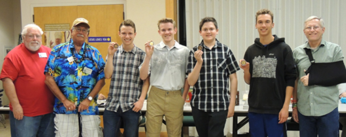 Honoring four high school seniors, left to right, Donald L. Hill and Michael S. Turrini extend congratulations from the Northern California Numismatic Association to Matthew Malvini, Granville B. Goza, Justin D. Blumstein and Alex Trigonis. Emile Mestressat III presided over the Cupertino Coin Club meeting.