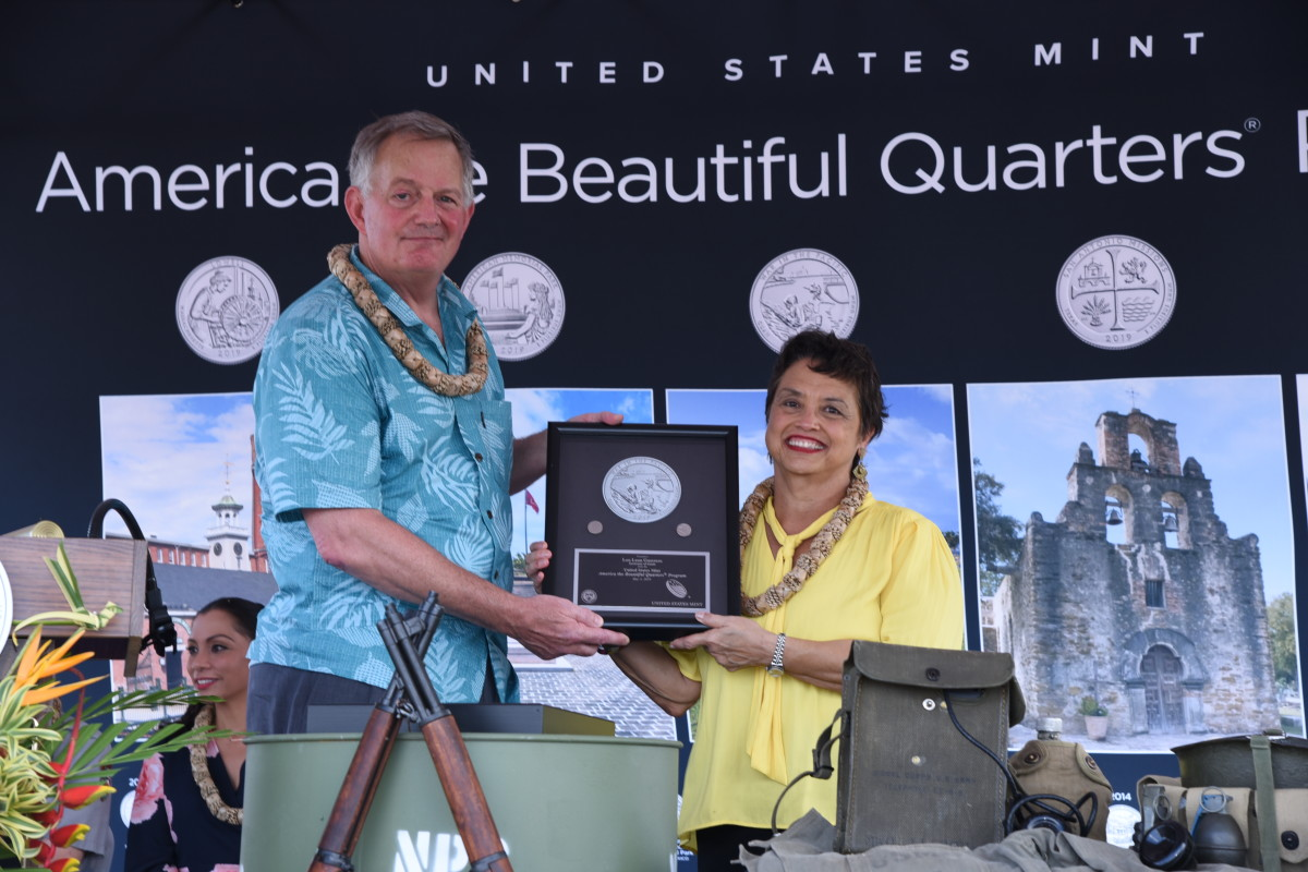 United States Mint Director David Ryder presents War in the Pacific National Historical Park quarters struck on the first day of production to Governor Lourdes Leon Guerrero during the May 3, 2019 launch ceremony in Asan, Guam. (U.S. Mint photo by Sharon McPike)