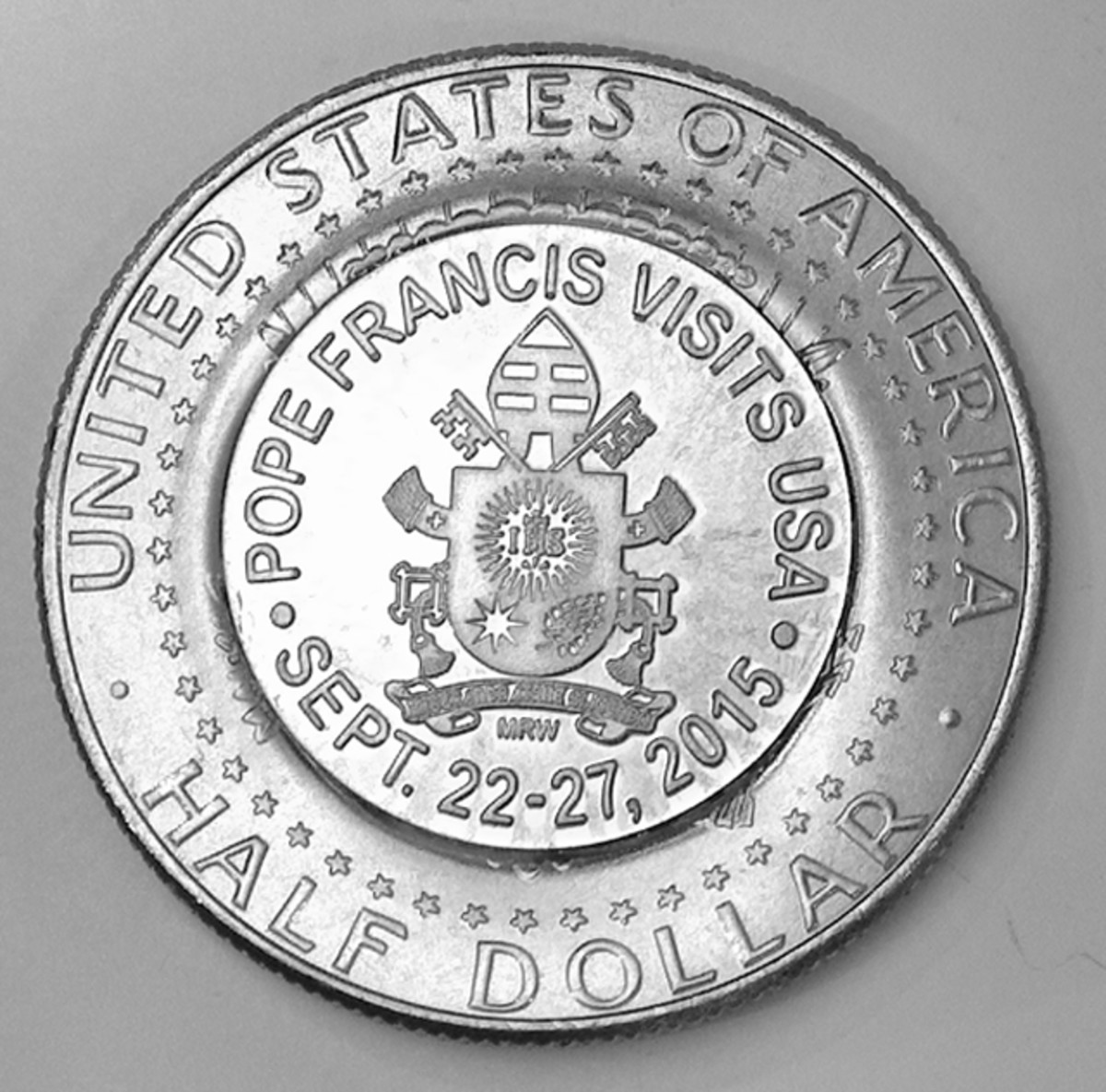 Mel Wacks' counterstamped half dollars commemorate Pope Francis' first visit to the U.S. in September.