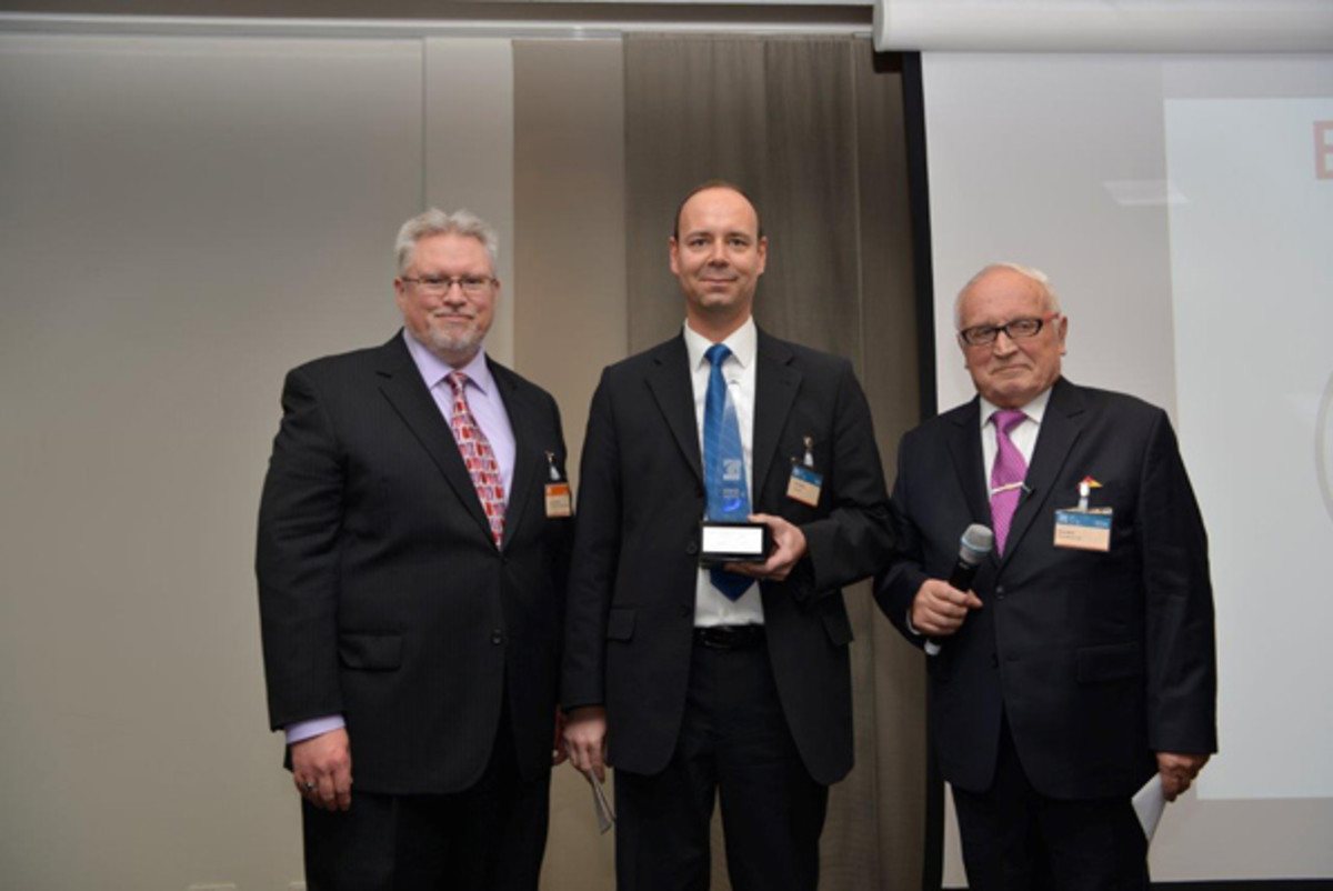 From left: Michael; Urs Liechti,head of marketing and sales, Swiss Mint (Best Contemporary Event Coin); and Beck.