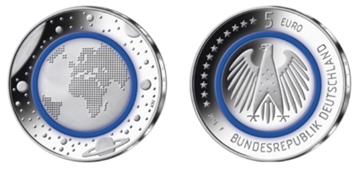 """The German Federal Ministry of Finance's 2016-dated """"Planet Earth"""" copper-nickel 5-euro coin with a blue polymer ring has been named the Coin of the Year. It also won the Most Innovative Coin category."""