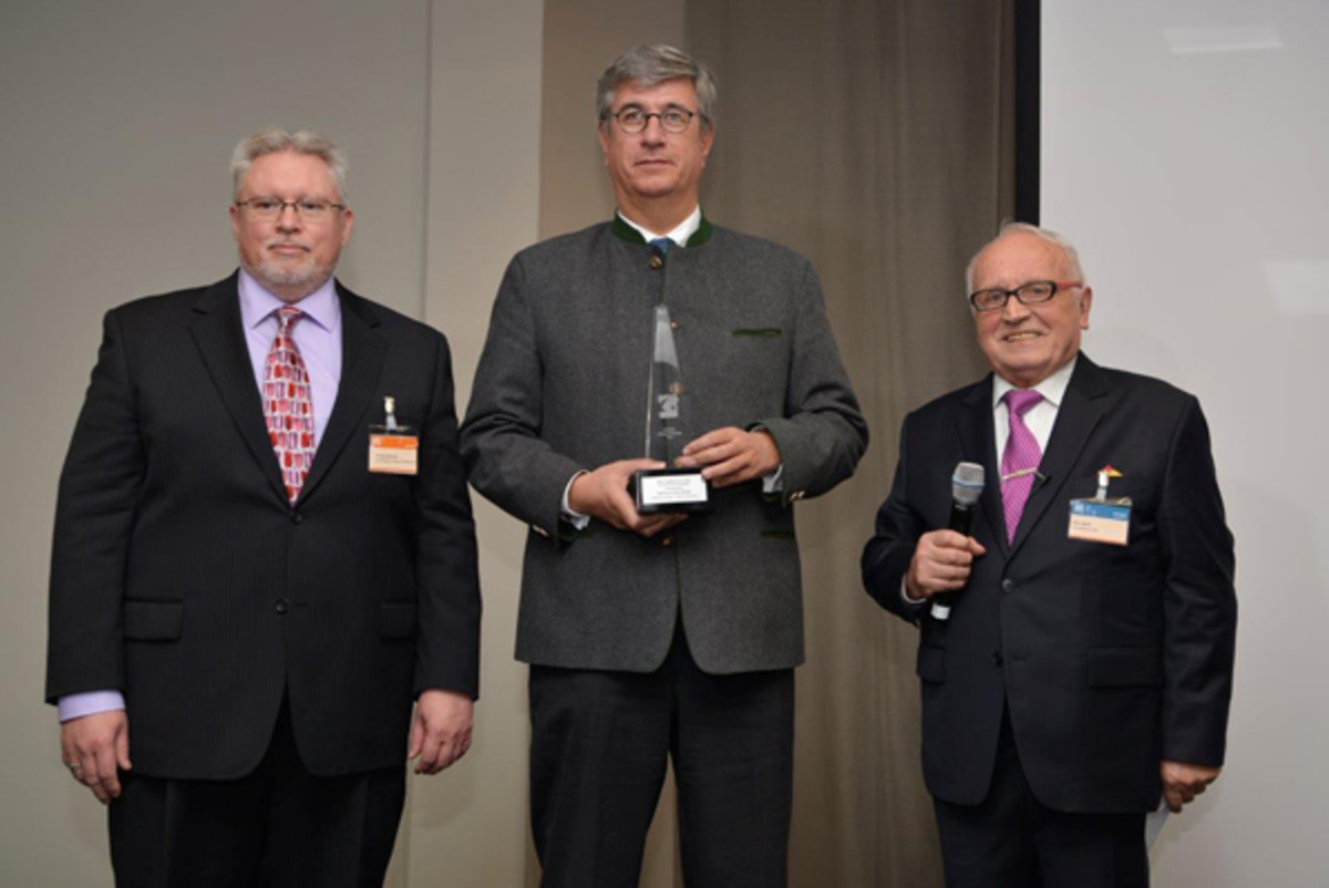 From left: Michael; Gerhard Starsich, CEO, Austrian Mint (two awards, Best Bi-Metallic Coin and Best Gold Coin); and Beck.