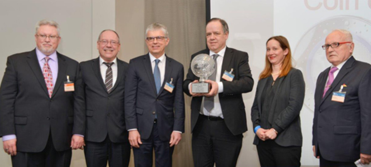 Germany accepts the Coin of the Year trophy: (from left) Thomas Michael, senior editor, Standard Catalog of World Coins; Günther Waadt, mint director, Bavarian State Mint; Dr. Peter Huber, mint director, Baden-Württemberg State Mint; Dr. Thomas Dress, coinage official, German Federal Ministry of Finance; Alina Hoyer, designer of eagle on the winning coin; and Albert Beck, founder, World Money Fair.