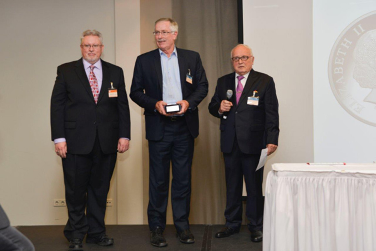 From left: Michael; Ross MacDiarmid, CEO, Royal Australian Mint (Best Silver Coin); and Beck.