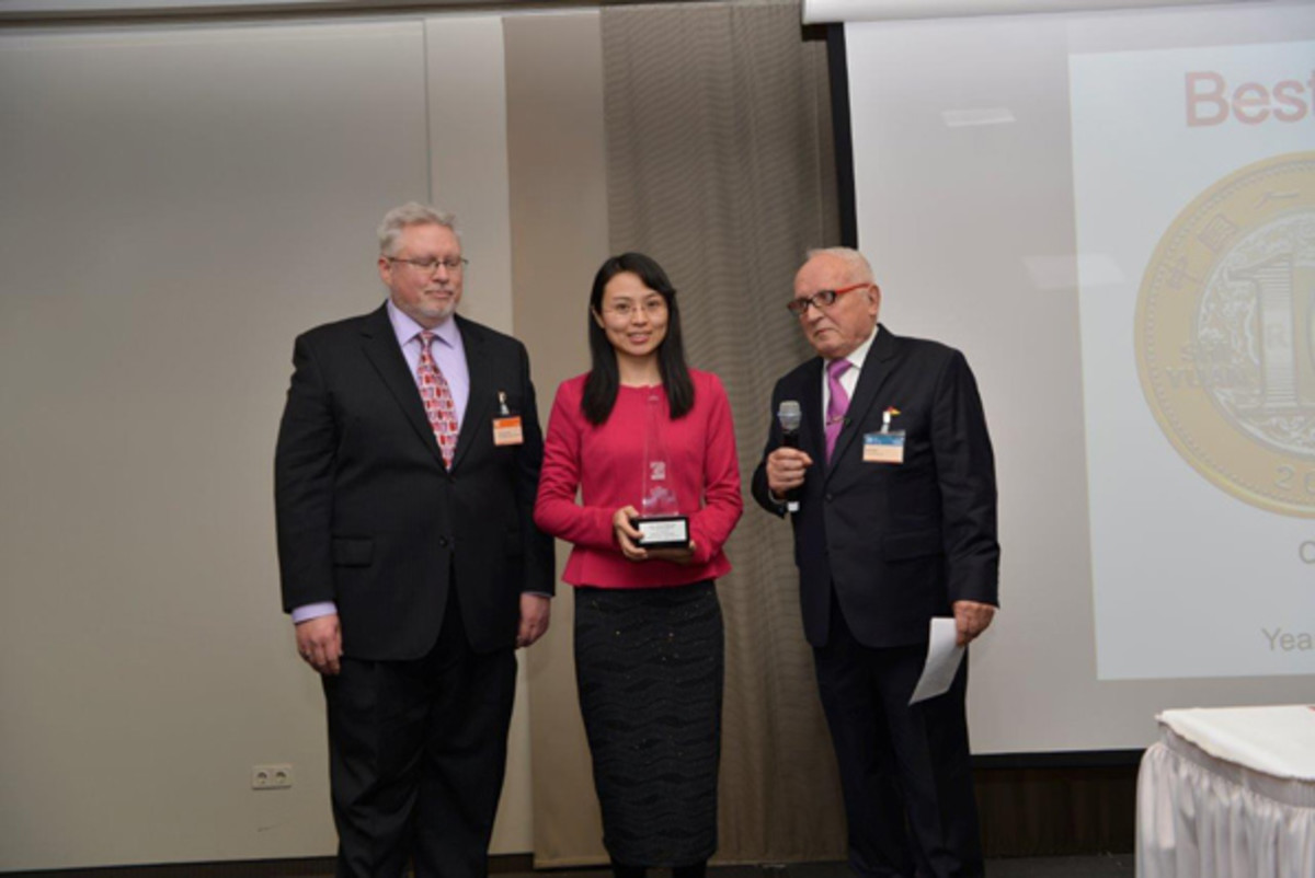 From left: Michael; Xue Chen, People's Bank of China, Frankfurt (Best Circulating Coin, China Banknote Printing and Minting Company); and Beck.