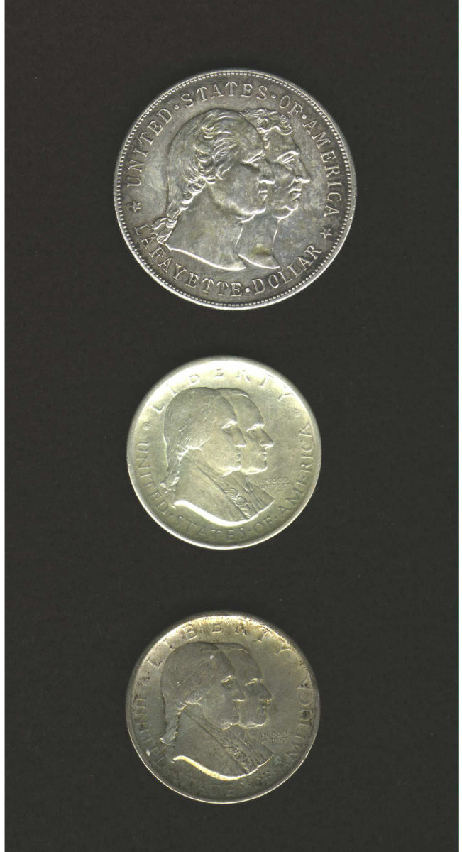 Shown here is a group of three Commemorative U.S. Coins. The coins included are: a 1900 Lafayette Dollar AU53, a 1926 Sesquicentennial Half Dollar VF25, and a 1926 Sesquicentennial Half Dollar VF35. (Images courtesy of Heritage Auctions.)