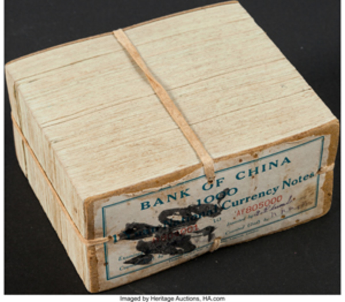 Bank of China brick of 1,000 consecutive 1937 one-yuan notes (P-79) that sold for $11,400.