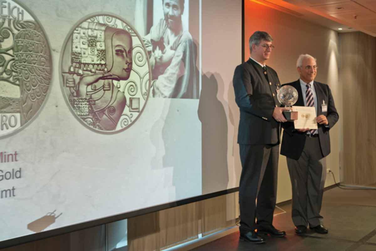 Donald Scarinci (right)  presents the 2015 Coin of the Year Award to Gerhard Starsich of the Austrian Mint for a 50-euro gold coin. It was also named Best Gold Coin.