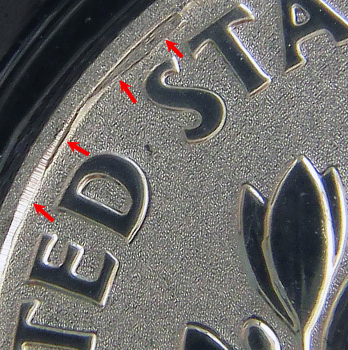 A rim-damaged die struck this reverse proof March of Dimes dime.