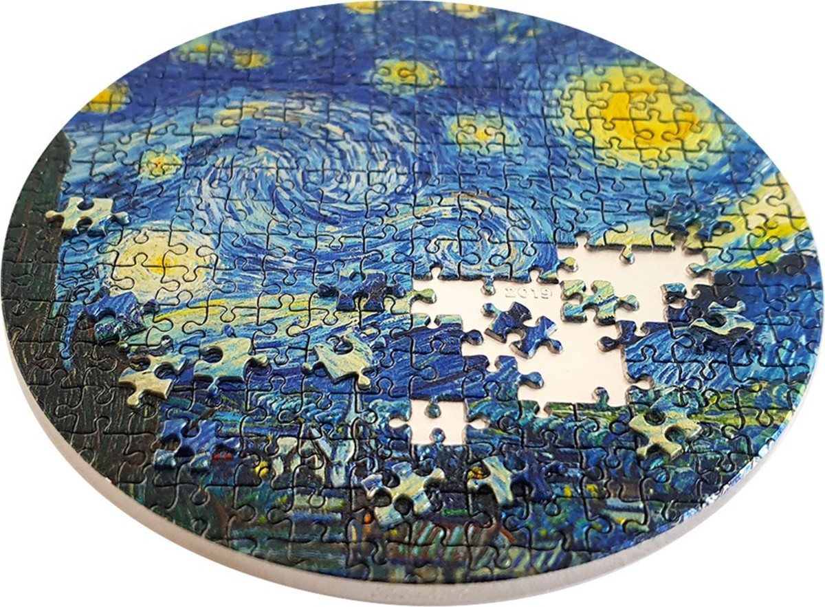 Viewed at an angle, the raised puzzle pieces and incuse empty puzzle spaces of Starry Night become amazingly clear. It is a complex coin that brings Power Coin's goal of combining classic works of art with coins in a fun presentation. The first in the Micropuzzle Treasures series, this coin has sold out and advanced in value by almost three times its original sales price. (Image courtesy Power Coin)