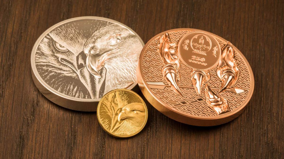 The first coins produced using the new Smartminting Reloaded technology were struck in silver, copper and gold for Mongolia. They feature close views of the head and talons of the Majestic Eagle native to that country. Mongolia is quite strict about using only homeland themes on their coinage. (Image courtesy CIT.)
