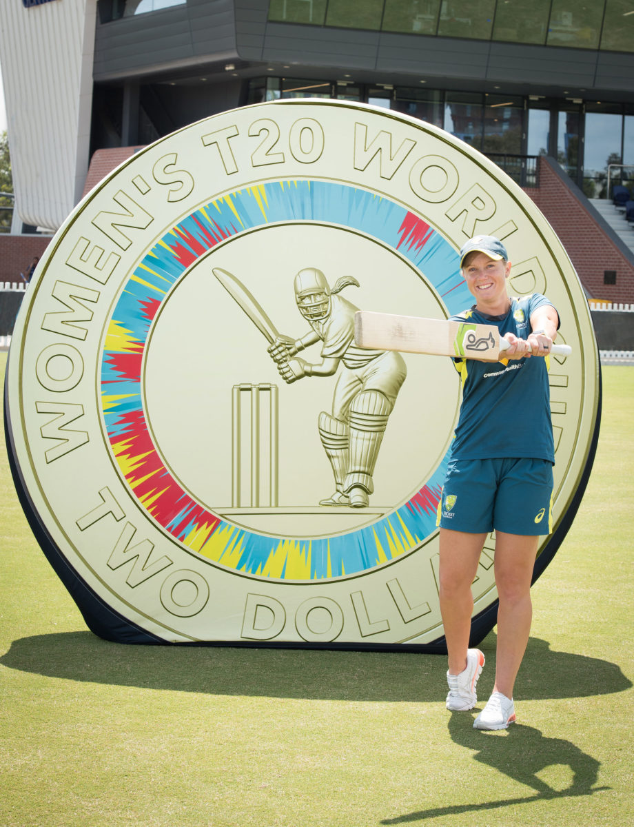 Alyssa Healy with ICC Women's T20 World Cup $2 colored uncirculated coin. (Image courtesy Royal Australian Mint)