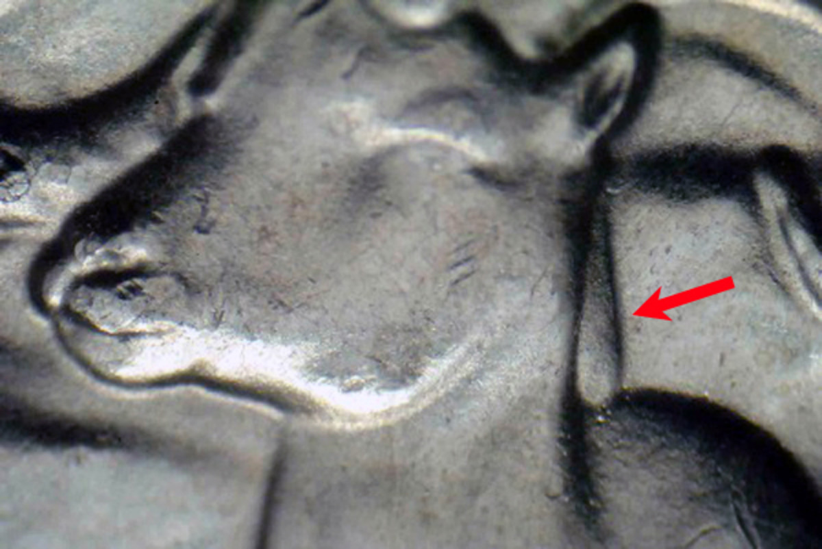 Doubling on the sheep's neck of a 2012-P Alaska Denali quarter is indicated by the red arrow.