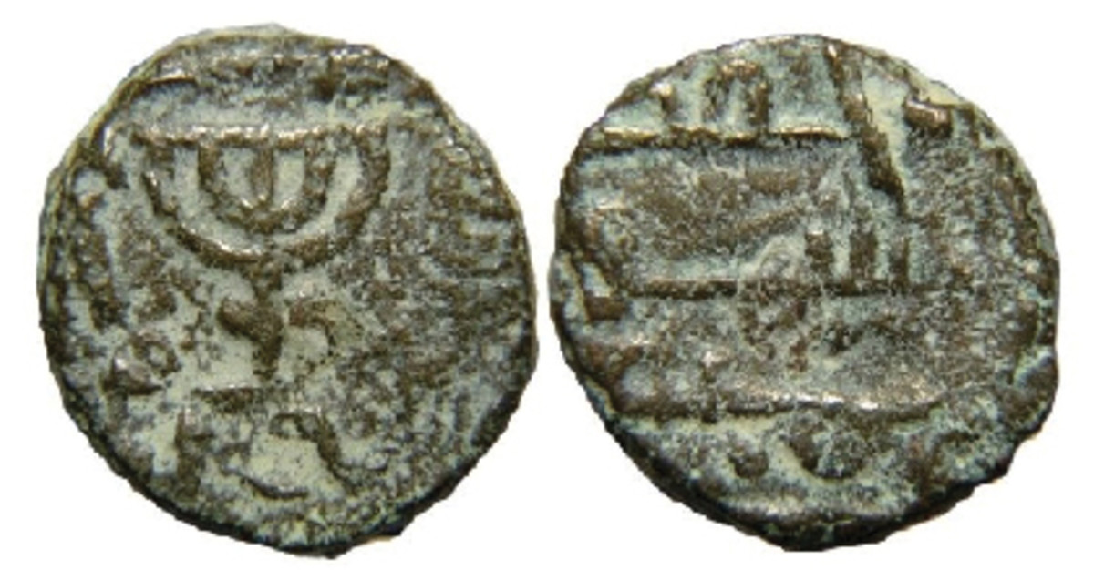 Is a menorah or the dome of a mosque the design element appearing on this Umayyad Caliphate bronze fals coin?